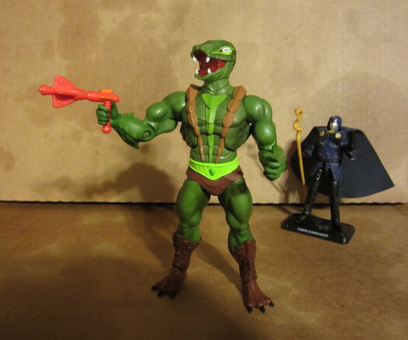 Kobra Khan with gun