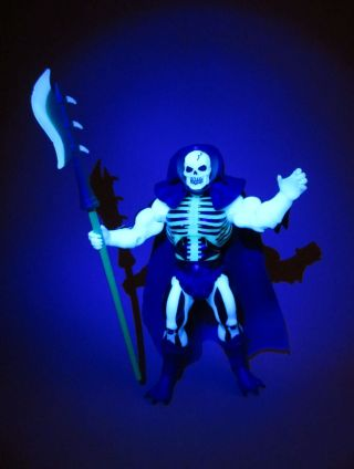 Scareglow with scythe under blacklight